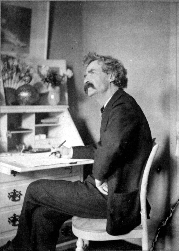 Mark_Twain_pondering_at_desk