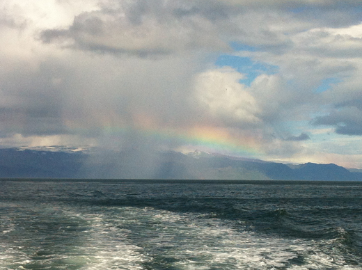 No elves out here in the ocean, where I caught a majestic rainbow rising above the mainland. I was riding to the Westman Islands, where a 1963 volcano birthed one of the world's youngest islands, Surtsey.